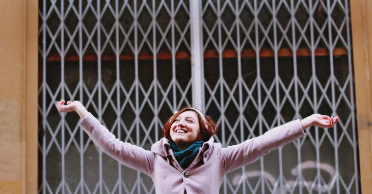 Happy woman celebrating lottery syndicate win